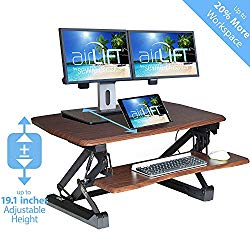 Walnut finish desk converter supporting dual monitors and tablet on upper tier