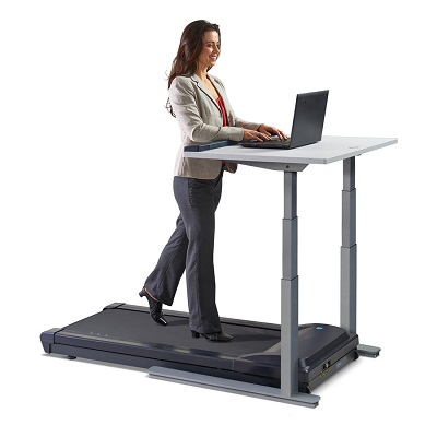 Woman walks on LifeSpan TR1200 treadmill whilst working on her laptop