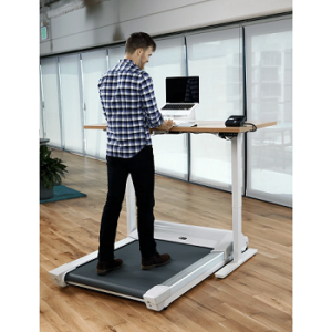 Man walking on treadmill whilst working on his computer