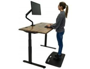 Woman working at the Lander standing desk with a solid wood top