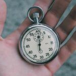 Silver encased stopwatch with white face and black numbering