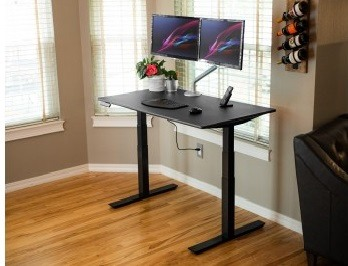 Side angle of the ZipDesk with black worktop and frame supporting dual monitors and laptop