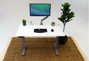 ZipDesk with white desktop and silver legs supporting a keyboard and monitor