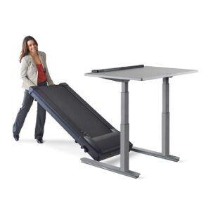 Woman rolling a lifeSpan treadmill underneath an adjustable standing desk