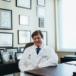 Doctor sitting at desk in his office