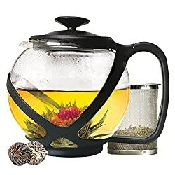 Glass teapot with 2 buds and a canister of tea leaves
