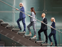 4 office workers walk up a flight of stairs