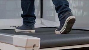 Close up of feet walking on an office treadmill