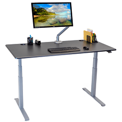 Electric standing desk with grey fram and brown desktop with keyboard, monitor and accessories
