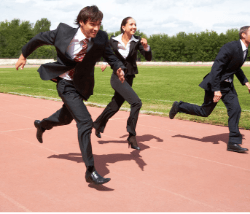 3 people running a race whilst wearing suits