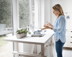 Woman working at semi-adjustable standing desk