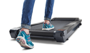 Close up of feet stepping onto a treadmill