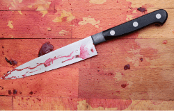 Chopping block with beets-stained knife