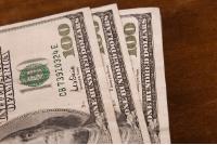 3 100 dollar bills
