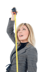 Woman holding a steel tape measure to measure her height