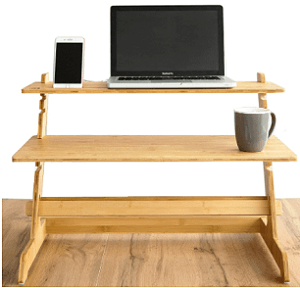 A wooden 2 tier desk converter with laptop and smartphone.