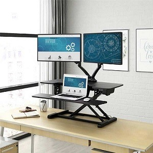 Electric adjusting standing desk converter with dual mounted monitors, laptop and mouse