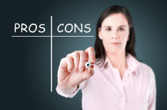 Woman holding out a pen with an empty list of pros and cons